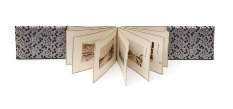 A concertina album of 32 original albumen photographs (each 100 x 140 mm.) of the famous Besshi Copper mining works, each mounted on thick board. Toshimo MITSUMURA, photographer.