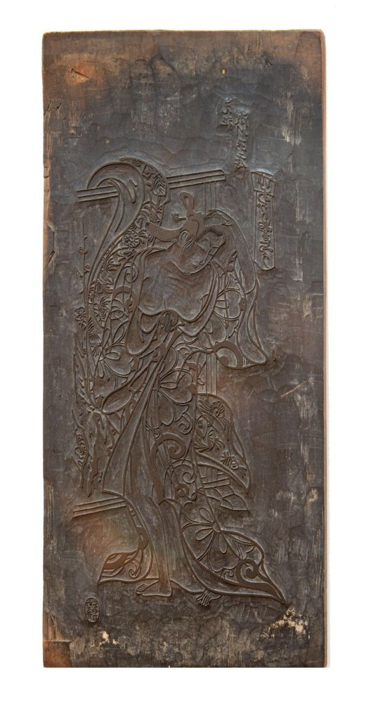 "Wooden board (420 x 203 x 13 mm.), carved on both sides, the obverse side with an image of a kabuki actor dressed as a woman, the reverse bearing two small sections of added patterns for the actor's kimono, the title reads: ""Agari yakkoren yo"" [""View of a Woman Freshly Bathed""]. KABUKI WOODBLOCK."