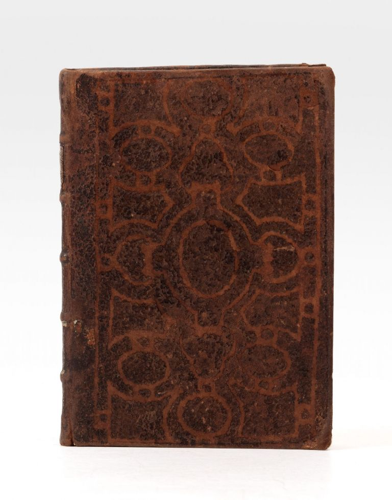 A rare and most unusual 18th-century binding of calf, the sides decorated with an ornate...