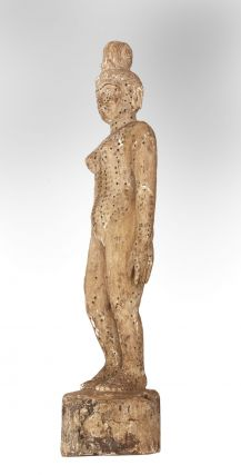 """An """"annotated"""" female acupuncture model, with pressure-point holes all over the body & characters for each point written in black, 835 x ca. 190 mm., five kilos (11 lbs.), sculpture carved from wood."""