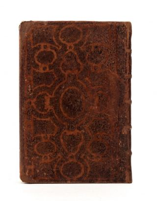 A rare and most unusual 18th-century binding of calf, the sides decorated with an ornate Grolieresque design, created by a stencil & acid treatment.